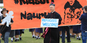 Protesters, including Peter Macleod Miller, rector of St Matthews, Albury, demand the government free the children on Nauru. Photo by Mike Welsh