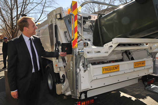Simon Corbell with a garbage truck (file image).