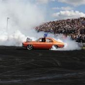 A car performing burnouts at Summernats 25.