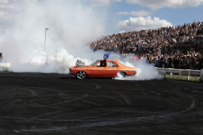 A car performing burnouts at Summernats 25.