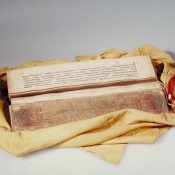 Silk sutra... this Tibetan Buddhist sutra, or religious manuscript, is wrapped in cotton decorated with a square of red silk, a practice that reflects the importance of the silk and the sacredness of the text. © Courtesy of the AMNH Division of Anthropology.