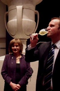 "A Parisian Toast: Curator Jane Kinsman looks on as Andrew Barr toasts ""Toulouse-Lautrec"" at this morning"