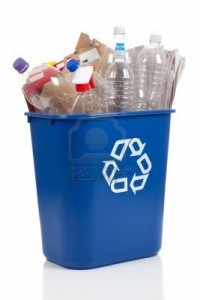 5384861-an-overflowing-blue-recycle-bin-full-of-plastic-bottles-newspapers-and-boxes-with-the-recyle-symbol-