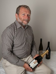 """President of the Canberra District Wine Industry Association, Allan Pankhurst, with the Centenary wine collection... the bubbly's """"got the lovely fruit from the Chardonnay and the firmness from the Pinot Noir. It really is a magic blend."""" Photo by Silas Brown"""