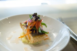 Salmon fillet with horseradish cream and pickled vegetables.