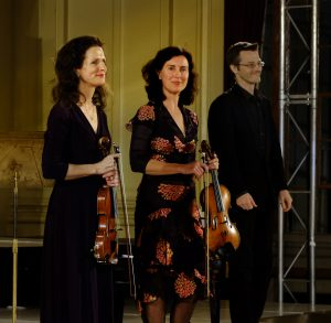 Violinists Madeleine Mitchell, left, and  Anna McMichael with pianist Timothy Young.
