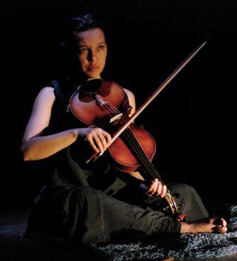 Soemardjo plays the viola, photo by Paula Van Beek