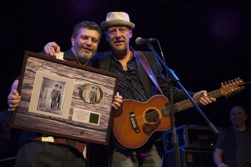 """Frog"" Harris, left, gets his award from singer Russell Morris. Photo by Michelle McAulay"