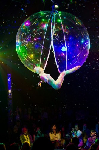 "Aerial artist Lucia Carbines as ""Miss A in a Bubble""... won an Australian national title for horse vaulting."