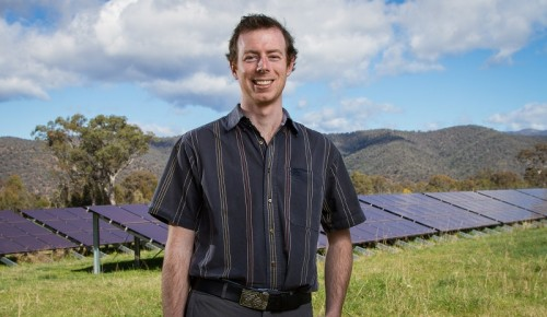 Lawrence McIntosh from SolarShare, at a small solar array in Kambah.