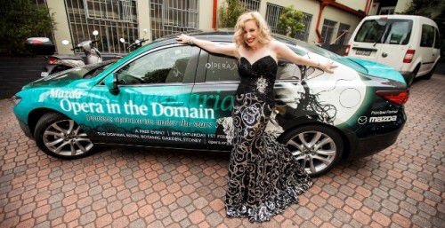 Lorina Gore poses with a Mazda-branded car used to promote Opera in the Domain Photo by Aidan Corrigan