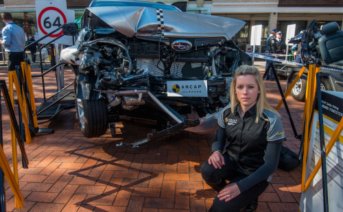 """Rhianne Robson with the Subaru Forester that survived the """"frontal offset"""" crash test and won the maximum five-star rating. Photo by Gary Schafer"""