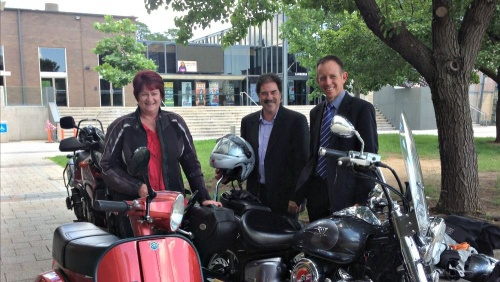 Minister Rattenbury is pictured with Ron Collins, NRMA ACT Corporate Affairs, and Jen Woods, President of the Motorcycle Riders Association