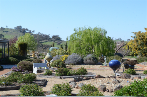 """Terroux"" at Hall… an eclectic mix of natives, ornamental trees, shrubs, annuals, perennials, bulbs and roses."