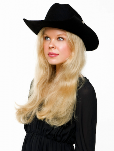 """Billy's great granddaughter, milliner Amelia Hughes, models her """"historically and personally significant garment""""... the custom slouch hat."""