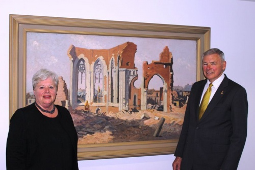 "Speaker Vicki Dunne and Rear Admiral Ken Doolan AO, RAN (Ret'd), chair of the AWM Council with Longstaff's painting ""Villers-Bretonneux, ruins of the church""."