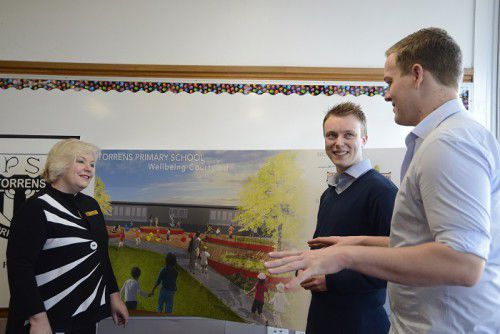 Torrens Primary School principal, Sue Mueller, with UC students  Christopher Norris and Luke Duggan