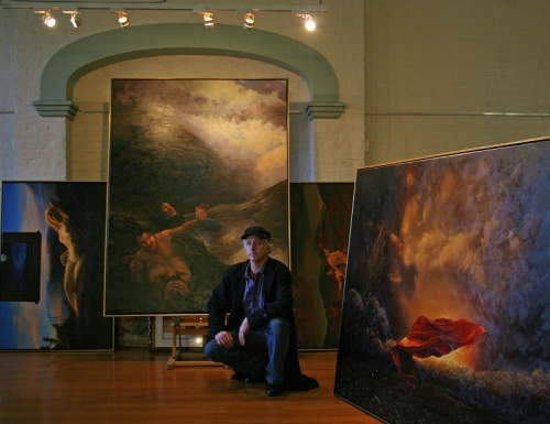 Nelson with some of his 'occult' paintings at Oddfellow's Hall