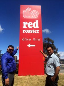 Vik Pandya and Vim Soneri outside the new Charnwood Red Rooster
