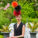 """Alice Anderson models Cynthia Jones-Bryson's prize -winning """"Fireworks"""" hat design… 100 hours in the making. Photo by Andrew Finch"""