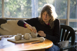 Fiona Hall at work, Image courtesy of the Australia Council for the Arts