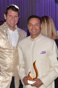 Aspiring Labor politician Deepak-Raj Gupta with his national award, right, with NSW Liberal Premier Mike Baird.