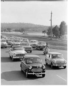 Cars exit Canberra in the '60s… holiday traffic would be gridlocked all the way over Queanbeyan's old timber bridge.