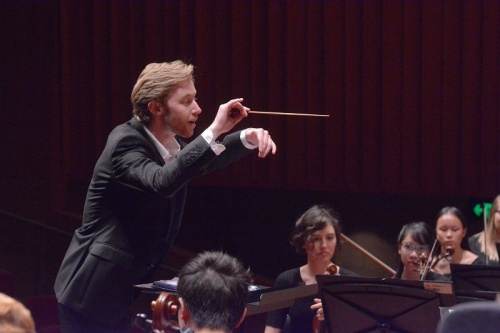 Leonard Weiss conducting, concertmaster Helena Popovic in background