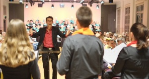 Tobias Cole conducting Vocal Envy, CCS Chorus in background - Photo by Hou Leong