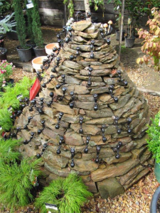 """A great project for children to build… this ant structure, made of stones, was spotted in Victoria. The """"ants"""" have been seen in garden centres and and toy shops."""