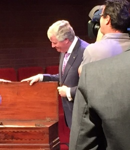 Prof Lancaster opening the lid of the First Fleet piano