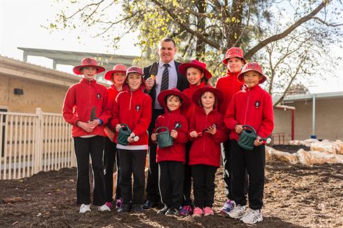 Mirko Milic with Aranda Primary School students, from left, Charlotte, Miranda, Thomas, Kayd, Frankie, Kairlyn, Emma and Kevin.