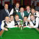 Steve Woods middle row, far wight) highlighted, with his triumphant teammates after winning in Blackpool. Photo by Martin Peach Photography, England