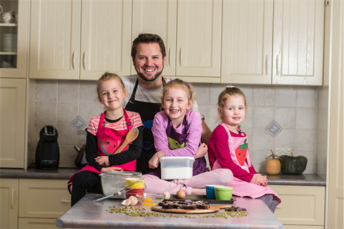 """James Clode, with daughters Charlotte, 7, Grace, 5, and Abigail, 3... """"The best part is the end, when we get to eat,"""" says Charlotte. Photo by Andrew Finch"""