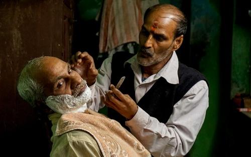 At PhotoAccess, Fiona Bowring-Greer, Man and his barber, Varanasi (detail), 2015, inkjet print