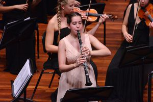 Rebmann plays clarinet