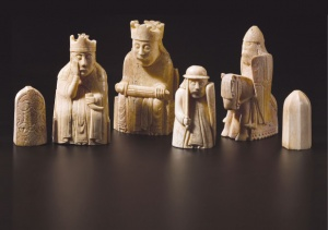 Six carved chess pieces, from left, a pawn, queen, king, rook, knight and pawn