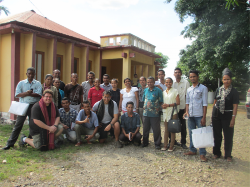 Dr Rob Sharwood, with red scarf, left, and David Johns, black scarf, with their class of East Timor science teachers in Maliana.