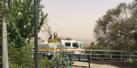 An Emergency Services crew keeps an eye on a dust storm in March across the Woden Valley from atop Red Hill.