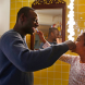 """Omar Sy in the role of Samuel and Gloria Colston as his eight-year-old daughter in """"Two is a Family""""."""