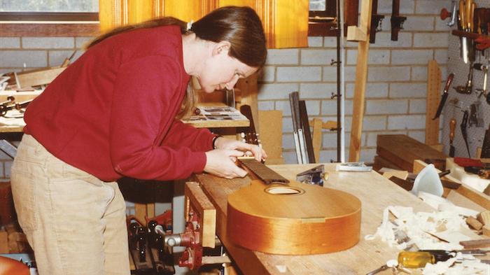 Gillian works on a mandolin.