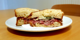 Reuben pastrami sandwich… a combo of pastrami, sauerkraut, wash-rind, smear-ripened Italian Taleggio cheese and pickle.  Photo by Wendy Johnson