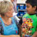 instructor and owner of Kumon Tuggeranong Education Centre, Jane Hiatt with a student.