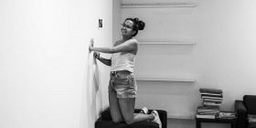 Aishah Kenton clearing out the gallery