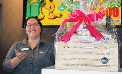 Canberra Labor Club receptionist Crystal Mende with a Mother's Day hamper.