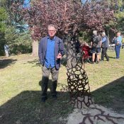 Bungendore sculptor Keith Bender with an outdoor work at the centre